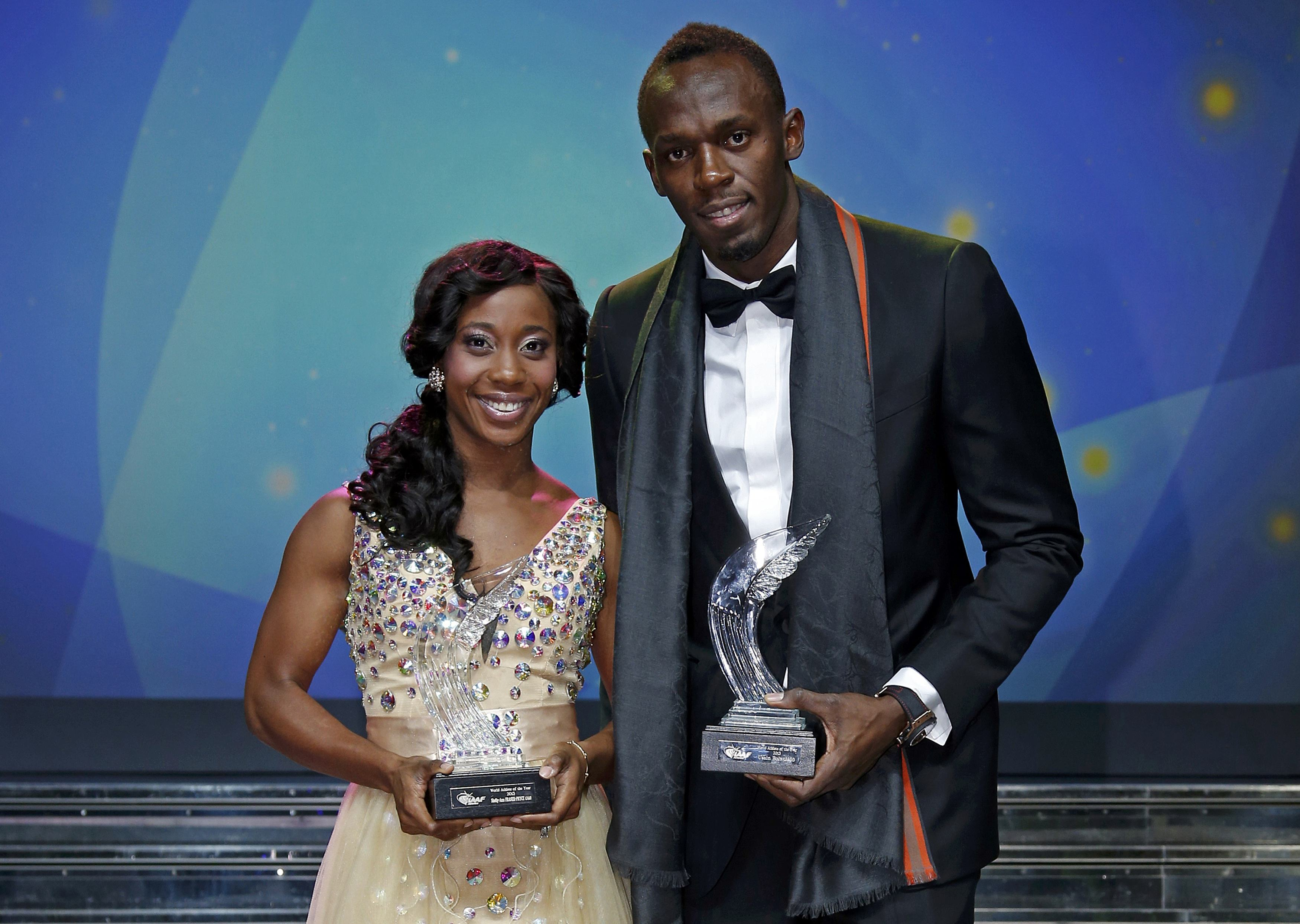 Usain Bolt and Shelly-Ann Fraser-Pryce of Jamaica pose after receiving their World Athlete of the Year awards during the IAAF World Athletics Gala in Monte Carlo